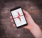 Electrocardiogram On A Smartphone - Concept Of Healthcare