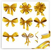 Set of gold gift bows with ribbons.