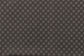 Texture Of Beige Fabric With An Abstract Pattern