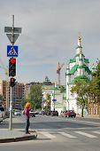 Girl crosses Street against Church of the Saviour
