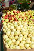 Many Ripe Apples In Cardboard Crates In The Market.