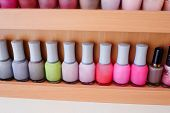 Close up of colorful nail polish bottles