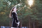 Beautiful Young Girl With Long Hair Standing In The Forest