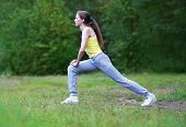 Fitness, Sport, Exercise, Workout Concept - Woman Doing Exercises In Forest