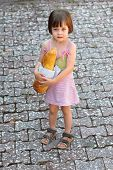 Adorable Little Girl Holding  A Loaf Of Bread