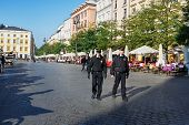 Policemen Patrol The City