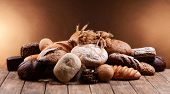 Different bread on table on brown background