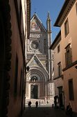 ORVIETO, ITALY - OCTOBER 22, 2014: People walk in front of the Orvieto Cathedral in Orvieto, Umbria, Italy.