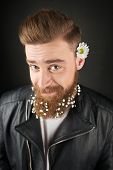Man with white flowers inside his beard