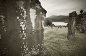 Scottish Graveyard And Loch Ness In Sepia Tone