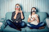 picture of mustache  - funny mom and daughter with false mustaches - JPG