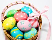 Colorful Handmade Easter Eggs In The Basket Isolated