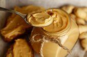 Fresh peanut butter in jar, close up