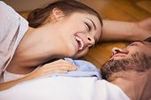 Smiling couple lying on the floor in their new home