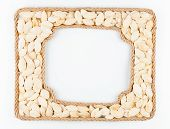Two Frames Of The Rope With Pumpkin Seeds On A White Background