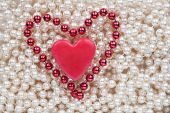 Two Hearts Lying On The White Beads