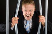 Businessman In Jail Bending Bars