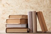 Stack of books on wooden hardboard background