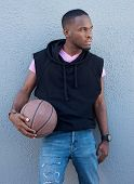 picture of swagger  - Portrait of a handsome young african american man holding basketball - JPG