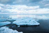 Winter Coastal Landscape With Floating Big Ice Fragments