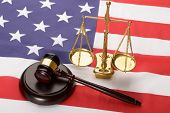 foto of scales justice  - Justice Scale And Wooden Brown Gavel On Usa Flag - JPG