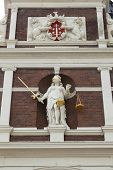 HAARLEM, NETHERLANDS - SEPTEMBER 26, Lady Justice in the facade of City Hall