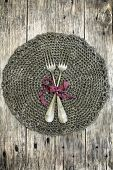 Beautiful decoration with two antique forks on handmade crochet doily.