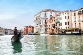 Gondola Sailing In Italian Water Canal