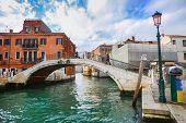 Tourists Walking On Bridge In Venice