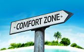 Comfort Zone sign with a beach on background