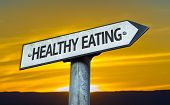 Healthy Eating sign with a sunset background