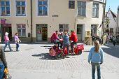 Tallinn. Estonia. Young people on a bike in Old Town