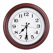 Round Clock Shows Half Past Seven