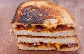 picture of ooze  - decadent grilled cheese and bacon sandwiches with oozing cheese running out - JPG