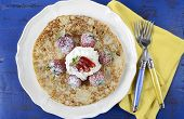 Shrove Pancake Tuesday Pancakes With Strawberries And Cream On Dark Blue Vintage Shabby Chic Table.