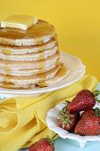 foto of tuesday  - Shrove Pancake Tuesday stack of pancakes with honey and butter on yellow and aqua blue vintage shabby chic table vertical with strawberries - JPG