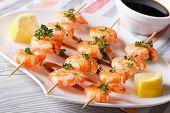 stock photo of braai  - grilled shrimp on skewers close - JPG