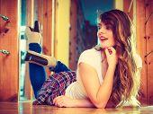 Girl In Denim Trousers Lying On Floor