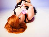 Lying Red Haired Woman With Lollipop.