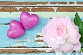 Pink Hearts And Pink Roses On Grungy Light Blue Wooden Background