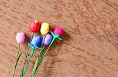 Colorful Artificial Tulips Flower Made From Silk Cocoon On Plywood Background