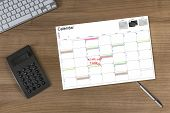 Calendar Kick-off And Calculator On Wooden Table