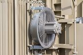 stock photo of fin  - Electrical cooling fan attached to the radiator fin of the transformer - JPG