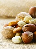 different kinds of nuts (almonds, walnuts, hazelnuts, pistachios)