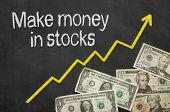 Text on blackboard with money - Make money in stocks