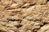 Closeup sandstone texture of warm colors.