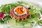 Beef tartare in plate, close-up �??�??�??��µ