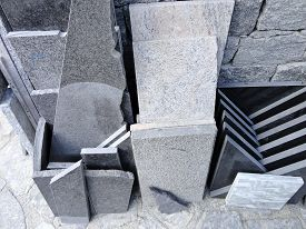 image of slab  - Several kinds of granite slabs stacked on the outside of a stone processing factory for cutting and polishing into flooring slabs used in building construction - JPG