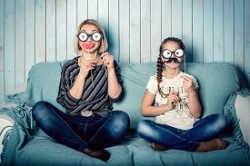 image of moustache  - funny mom and daughter with false mustaches - JPG