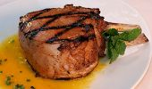 picture of pork chop  - freshly grilled pork chop garnished with mint - JPG